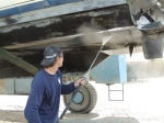 Time and Tide gets a pressure wash to prepare her hull for a new coat of paint