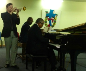 Jazz improvisation and hymns at a New Orleans worship service. Oh, yeah!