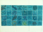Tile art display of faith symbols in the pool area